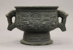 A small Chinese bronze archaic style censer. 14 cm wide.