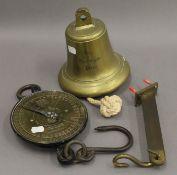 A Salter hanging balance and a brass bell. The latter 17.5 cm high.