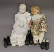 Two dolls and a collection of vintage child's shoes.