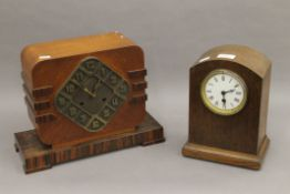 An Art Deco oak mantle clock and another oak mantle clock. The former 27 cm high.