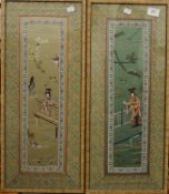 A pair of Chinese embroidered silk panels, each framed and glazed. 27.5 x 64.5 cm overall.