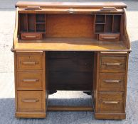An early 20th century oak roll top desk. 116 cm wide.