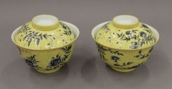 A pair of Chinese yellow ground florally decorated lidded bowls. 12.5 cm diameter.
