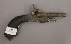 A 19th century double barrelled pistol. 18.5 cm long.