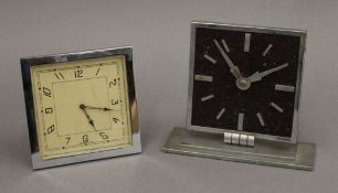 Two Art Deco style clocks. The largest 14 cm high.