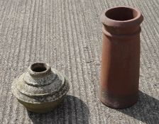 An early ceramic urn and a chimney pot.