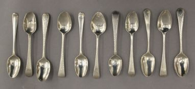 A quantity of silver teaspoons, including two Hester Bateman Hanoverian shell back teaspoons. 4.