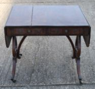 A 19th century mahogany sofa table. 85 cm wide flaps down.