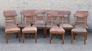 A set of 16 Victorian oak dining chairs. Each 48 cm wide.