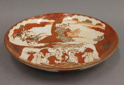 A 19th century Satsuma dish. 30.5 cm diameter.