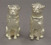 A pair of silver plated dog formed salt and peppers. 6 cm high.