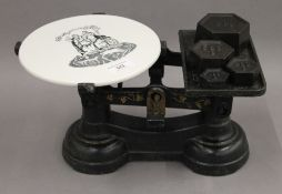A set of Victorian grocer's scales, with ceramic plate. 35 cm wide.