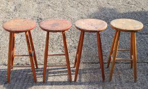 Four vintage stools.
