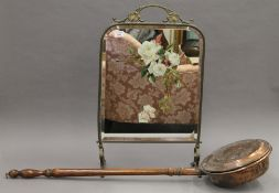 A painted brass framed fire screen and a copper warming pan.