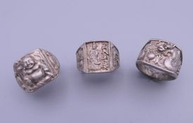 Three Chinese rings. Ring sizes O and P.