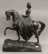 A Victorian bronze equestrian figure of the young Queen Victoria modelled riding side saddle,