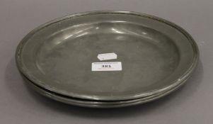 Three James Dixon pewter plates. 23 cm diameter.