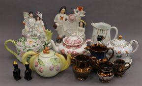 Four decorative porcelain teapots, two Staffordshire figures, etc.