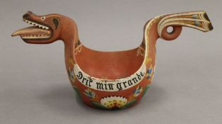 A 19th century Norwegian Folk Art painted wood marriage cup in the form of a sea serpent.