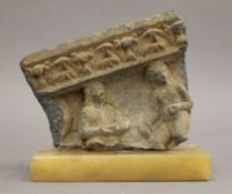 An antique, possibly 3rd/4th century Gandharan onyx sarcophagus fragment, mounted on an onyx base.