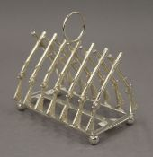 A rifle formed toast rack. 11.5 cm long.