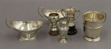 A quantity of silver items, including twin handled pedestal salts. The salts 12 cm wide.