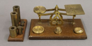 A small set of brass scales and various weights. Scales 20 cm wide.
