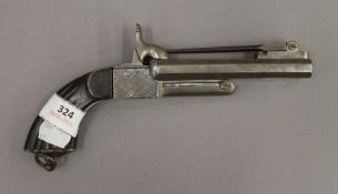 A 19th century double barrelled pistol with fold out bayonet. 21.5 cm long with bayonet folded.