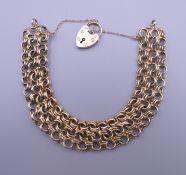 A 9 ct gold woven link bracelet. 21.8 grammes. Approximately 16 cm long.