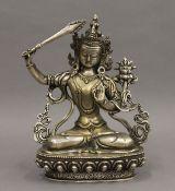 A Tibeto-Chinese silvered bronze figure of Manjushri. 20.5 cm high.