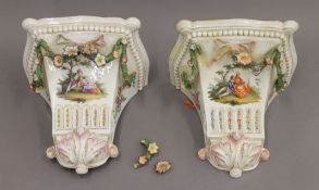 A pair of Continental porcelain wall brackets. Each 22.5 cm high.