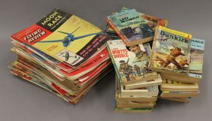 A quantity of vintage Flying Review magazines, Commando books, etc.