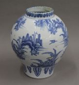 An 18th century Delft pottery vase. 29 cm high.