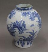 An 18th century Delft pottery vase. 29 cm high.