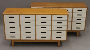 A pair of mid-20th century white painted banks of school drawers. Each 120 cm wide.