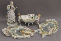 A pair of Continental porcelain mirrors; together with various porcelain. The former each 46.