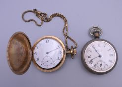 A gold plated pocket watch and another. The former 5 cm wide.