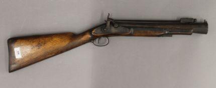 A 19th century percussion coaching gun. 74 cm long bayonet folded.