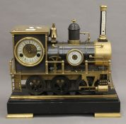 A large brass mounted train form clock. 40 cm long.