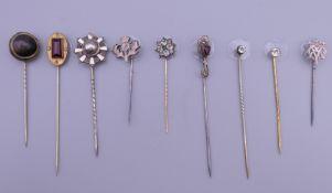 A quantity of antique stickpins. The largest 7.5 cm high.