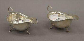 A pair of silver sauce boats. Each 14.5 cm long. 5.7 troy ounces.