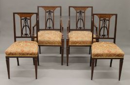 A set of four Edwardian inlaid mahogany dining chairs, including two with arms. 54 cm wide.