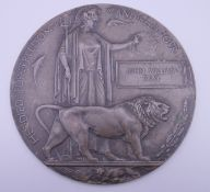 A WWI bronze death plaque, awarded to John William Bray.
