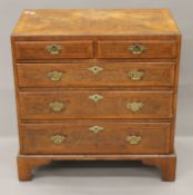 An 18th century and later walnut chest of drawers. 72 cm wide.