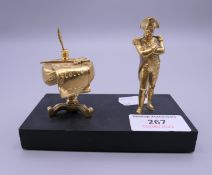 A small bronze model of Napoleon on a plinth base. 11.5 cm wide overall.