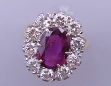 An 18 ct gold and platinum ruby and diamond ring. Ring size H/I (with previous sizing mounts). 1.