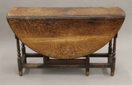 An 18th/19th century oak gate leg table. 128 cm long.