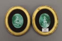 A pair of framed 19th century porcelain plaques. 15 x 17.5 cm overall.
