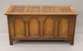 An early 20th century oak panelled coffer. 122 cm long.