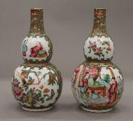 A pair of 19th century Canton double gourd vases. Each 19 cm high.